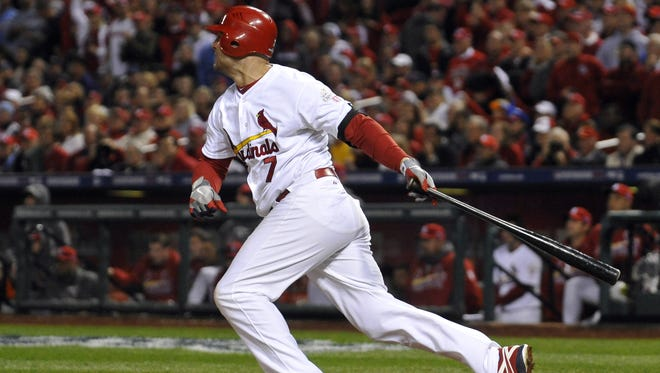 Matt Holliday hits an RBI single against in the fifth inning to give the Cardinals a 3-1 lead.