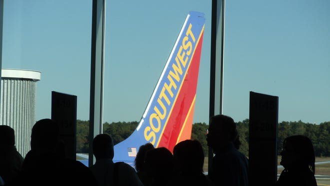 Passengers wait to board a Southwest Airlines flight at Long Island MacArthur Airport in New York on Oct. 7, 2010.