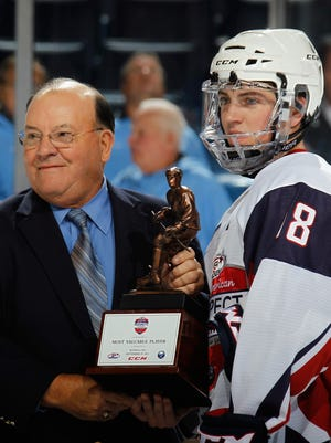 Ryan Fitzgerald receives the MVP trophy as the Top Prospects Game from Scotty Bowman.