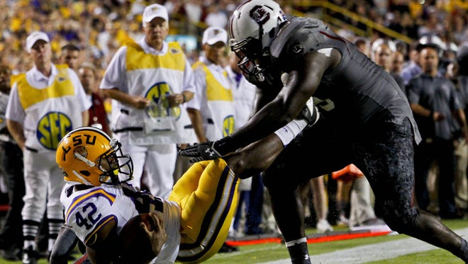 South Carolina defensive tackle Kelcy Quarles will sit out Saturday's game against Florida after he was suspended for throwing a punch during last weekend's loss at LSU.