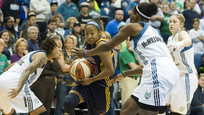 Fever guard Briann January, center, drives to the basket against Lynx center Taj McWilliams-Franklin, right, and guard Seimone Augustus, left, during Game 2. January suffered a concussion when the Fever played the Lynx in Minneapolis on Sept. 17.