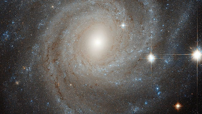An image from the Hubble Space Telescope on Oct. 15 shows NGC 3344, a spiral galaxy half the size of the Milky Way. The galaxy is 25 million light-years away.