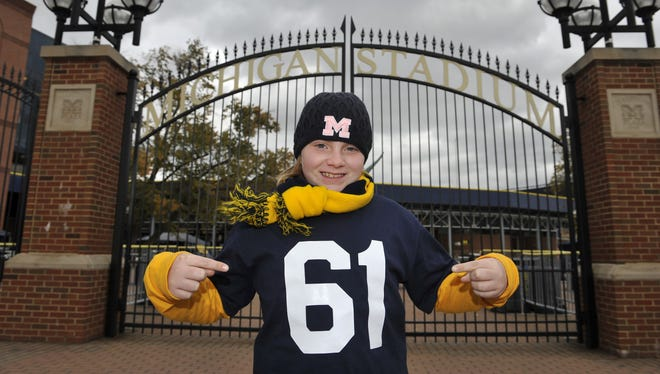 Eight-year-old Genna Urbain of Brighton, Mich., wears a No. 61 Michigan jersey in honor of  Willis Ward on Oct. 10, 2012 in front of Michigan Stadium in Ann Arbor, Mich. Urbain watched a documentary film about Willis Ward and successfully lobbied state legislators and the U-M Board of Regents to make this Oct. 20th Willis Ward Day.