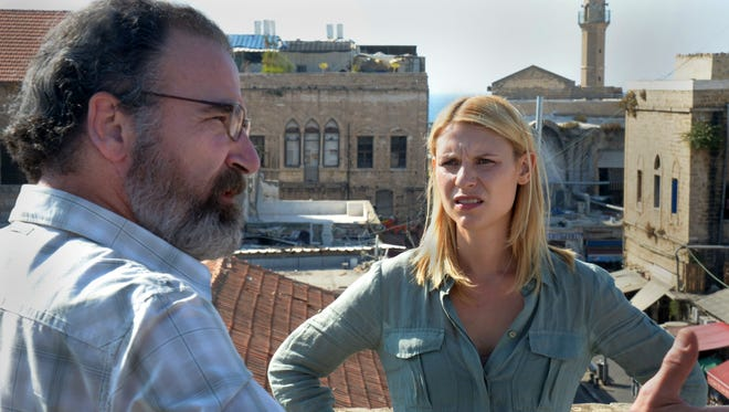 "This image released by Showtime shows actors Claire Danes and Mandy Patinkin in a scene from the second season of ""Homeland,"" which was filmed in Israel."