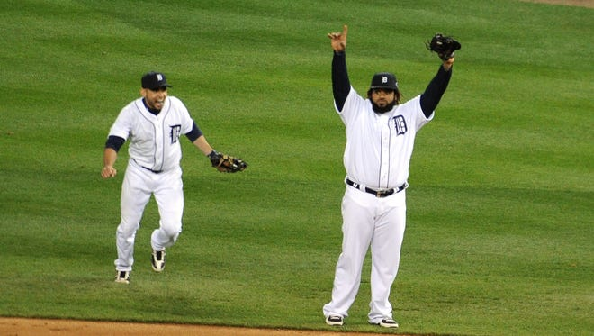 Tigers first baseman Prince Fielder (right) and second baseman Omar Infante (left) celebrate after sweeping the Yankees.