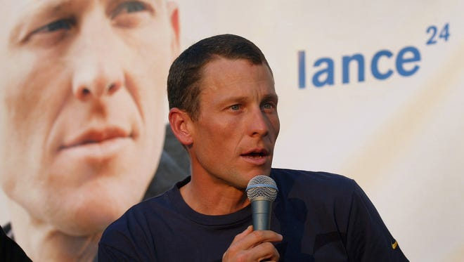 Lance Armstrong says he's gone through a rough couple of weeks in the wake of being stripped of his Tour de France titles for allegedly doping.