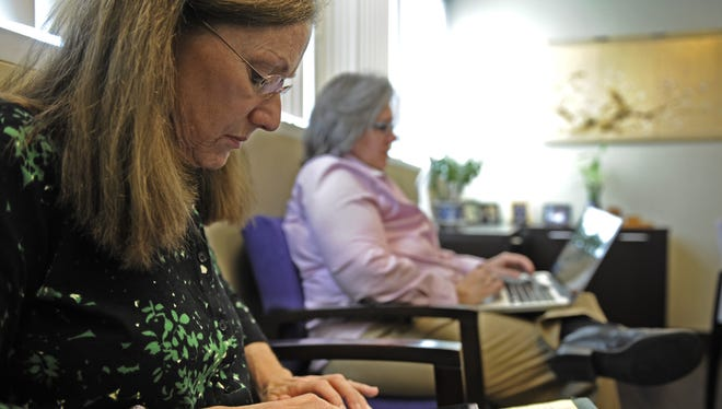 Cancer survivors Jody Schoger, left, and Alicia Staley tweet and blog Oct. 2 in the office of  Dr. Deanna Attai in Burbank, Calif.