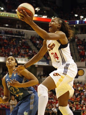 Tamika Catchings, right, the 2011 WNBA MVP, is one win away from adding the final piece to her basketball resume. Catchings and the Fever hope to close out Maya Moore, left, and the Lynx in Game 4 Sunday in Indianapolis.