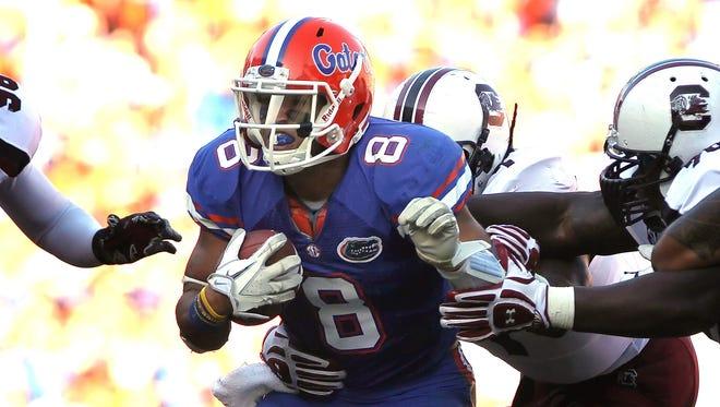 Florida running back Trey Burton and the fourth-ranked Gators remained unbeaten Saturday.