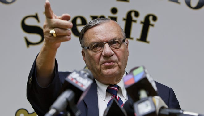 Maricopa County Sheriff Joe Arpaio, talks with the media at his Phoenix offices in August.