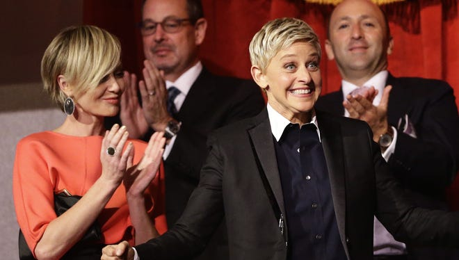 Entertainer Ellen DeGeneres reacts as she is introduced for the 15th annual Mark Twain Prize for American Humor at the Kennedy Center on Monday. DeGeneres' wife, Portia de Rossi, is at the left.