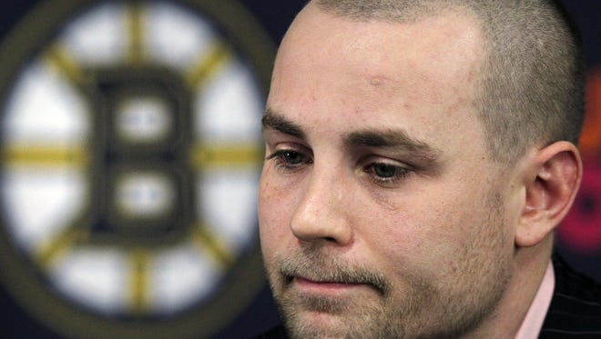 Boston Bruins forward Marc Savard announces in February 2011 that he was being shut down for the season.