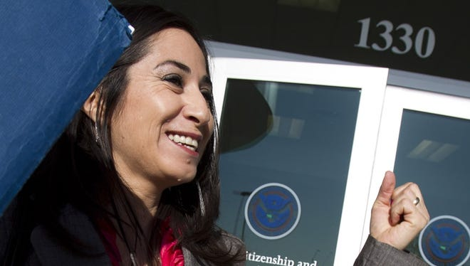 Ivone Moreno celebrates outside the Phoenix offices of U.S. Citizenship and Immigration Services after passing the citizenship test in April.