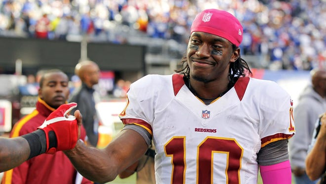 Robert Griffin III has 2,069 all-purpose yards and a completion rate above 70% in his rookie season with the Washington Redskins.