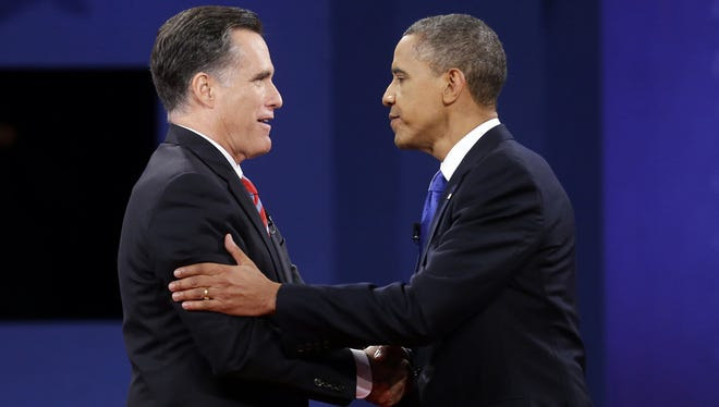 Republican presidential candidate, former Massachusetts Gov. Mitt Romney and President Barack Obama shake hands at the end of the last debate at Lynn University, Monday, Oct. 22, 2012, in Boca Raton, Fla.
