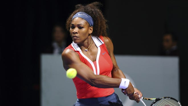 Serena Williams lines up a backhand during her victory Wednesday against Li Na of China in the WTA Championships.