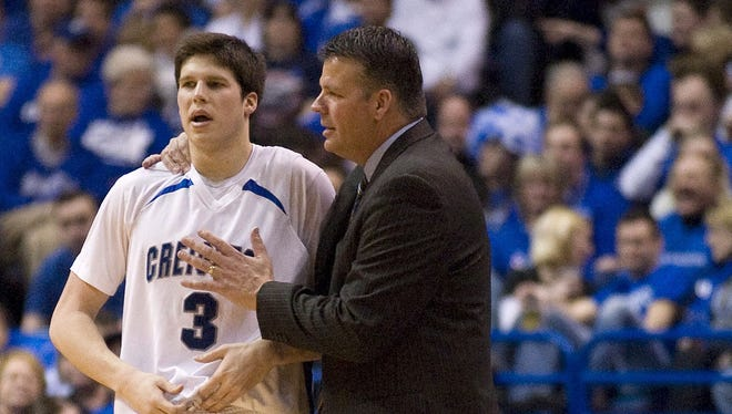 Creighton's Doug McDermott, left, returns for his junior season after an All-American sophomore campaign. His father, Greg, is the head coach for the Blue Jays.