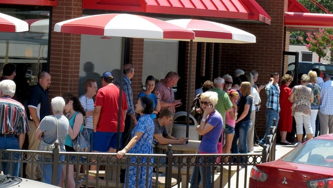 Customers wait in a  line outside to order at  the Chick-fil-la location on Aug. 1, 2012, in Longview, Texas.