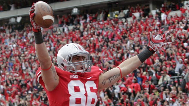 Ohio State tight end Jeff Heuerman celebrates his two-point conversion in Oct. 20's football game against Purdue University in Columbus, Ohio. The team, which can't win the championship, has a perfect record anyway so far.