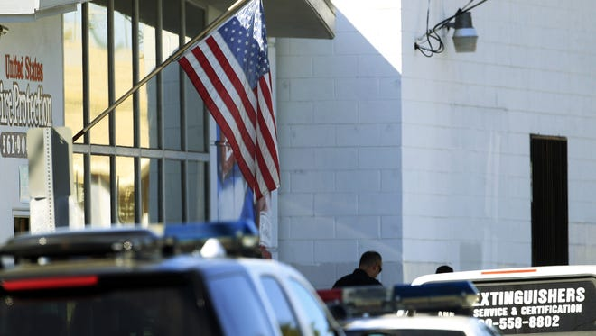 Four people were shot Wednesday morning, two fatally, at the family-run United States Fire Protection Services in Downey, Calif., about 20 miles southeast of Los Angeles. Police later found a woman shot dead at the owner's nearby home.