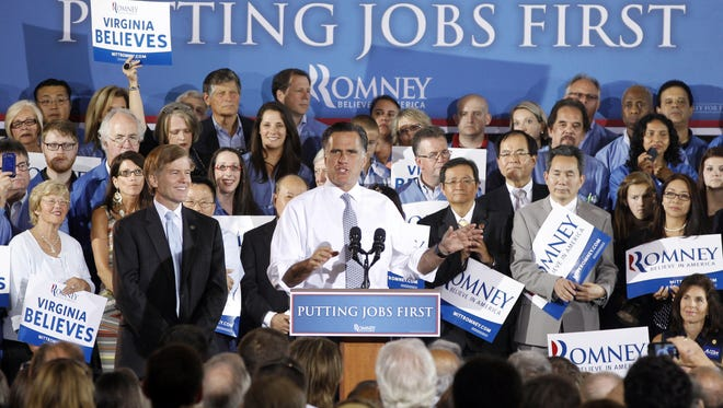 Republican presidential candidate Mitt Romney, accompanied by Virginia Gov. Bob McDonnell, left, campaigns in Sterling in June.