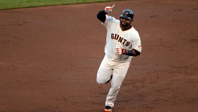 Pablo Sandoval's three home runs led the Giants over the Tigers and Justin Verlander in Game 1.