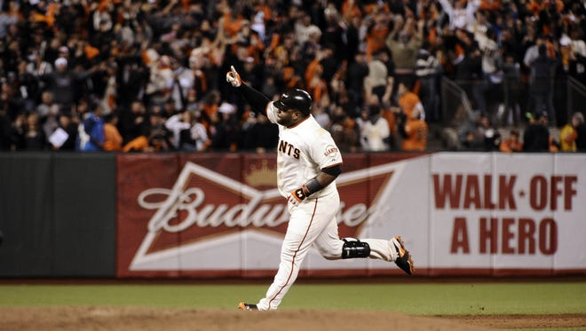 Pablo Sandoval rounds the bases on the second of his three home runs.