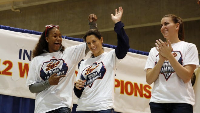Finals MVP Tamika Catchings, left, clowns around with assistant coach Stephanie White, center and teammate Jeanette Pohlen during the Fever's WNBA championship celebration Tuesday in Indianapolis.