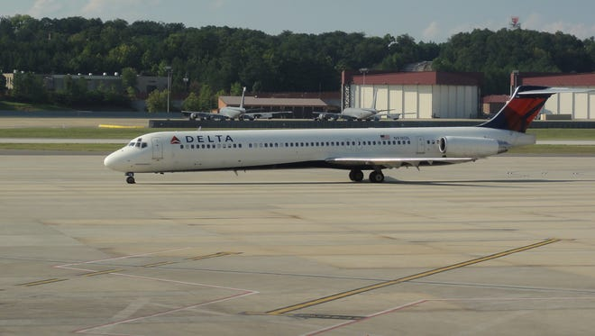 A Delta Air Lines MD-88 jet taxis at Birmingham-Shuttlesworth International Airport on Sept. 13, 2012.