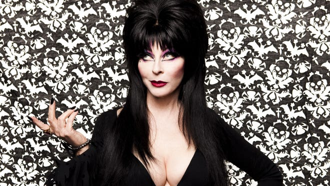 Cassandra Peterson as Elvira, Mistress of the Dark.