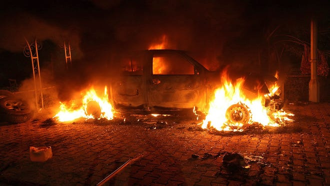 A vehicle and the surrounding area are engulfed in flames after it was set on fire inside the U.S. consulate compound in Benghazi, Libya on Sept. 11, 2012.