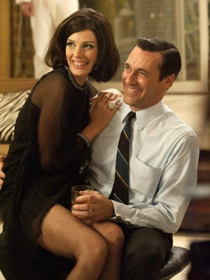 Jessica Pare and Jon Hamm get to ditch the party clothes for beach wear next season.