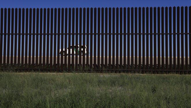 A U.S. Customs and Border Protection vehicle passes along the U.S.-Mexico border fence in Brownsville, Texas, Sept. 4.