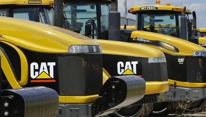 Caterpillar cut its profit and revenue guidance on Monday, Oct. 22, 2012, saying the world's economic conditions are weaker than we had previously expected.
