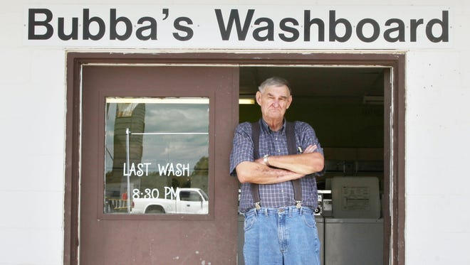 Richard Eggars stands in the doorway of a laundromat in Carlisle, Iowa that has come back to haunt him.