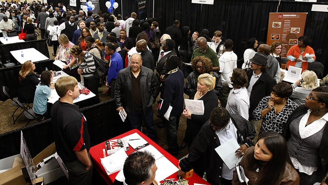 Hundreds of job applicants attend the DeSoto County Job Fair at Landers Center, Oct. 9, 2012, in Southaven, Miss.