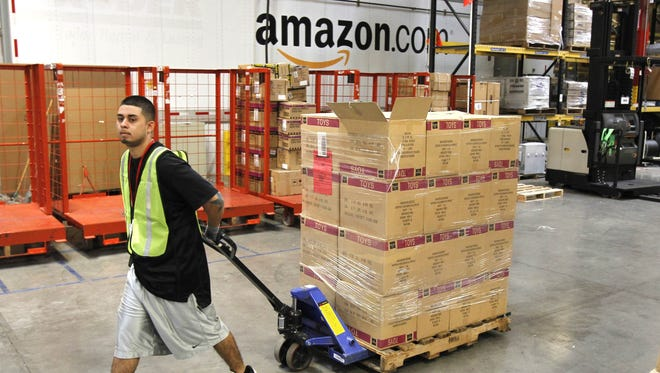 Humberto Manzano Jr. delivers a pallet of goods at an Amazon.com fulfillment center in Phoenix in this file photo.