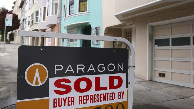 A sold sign in front of a home in San Francisco.