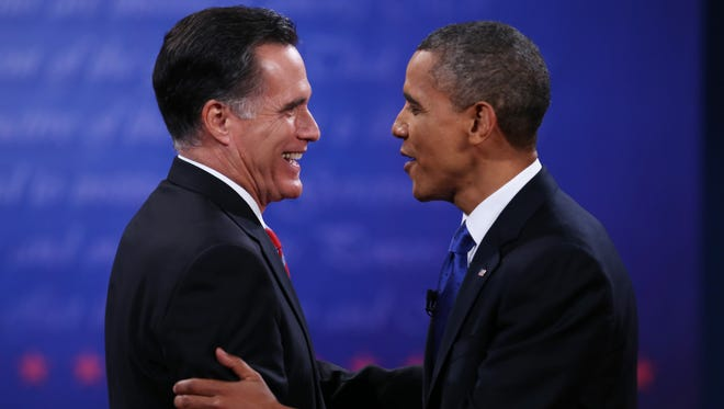 President Obama and Mitt Romney shake hands following the final presidential debate on Monday in Boca Raton, Fla.
