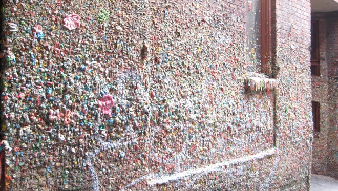 When Seattle residents are done chewing, they stick the remains on the city's spectacularly gross Gum Wall.