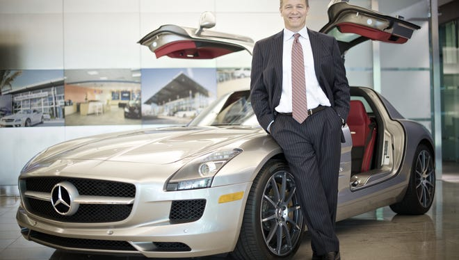 Stephen Cannon, CEO of Mercedes-Benz USA, shows off the SLS AMG