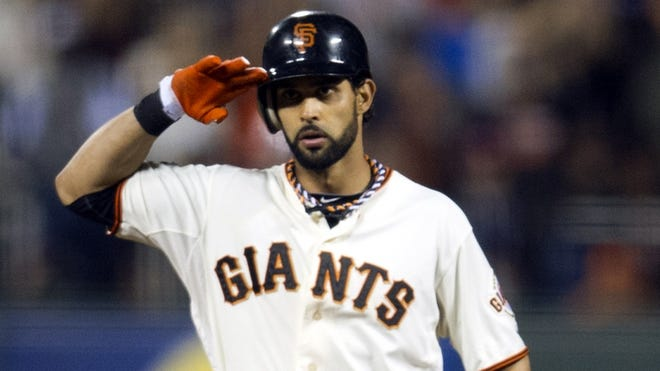 Angel Pagan (16) salutes after hitting a double against the Detroit Tigers during the seventh inning of Game 1 on Wednesday.
