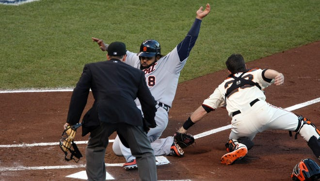 Detroit Tigers first baseman Prince Fielder is tagged out at home plate by San Francisco Giants catcher Buster Posey in the second inning.