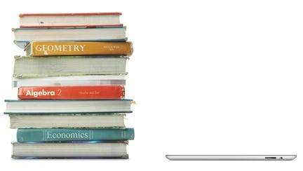 How do textbooks stack up against an iPad? College bookstores are now competing with e-books by offering rental textbooks.