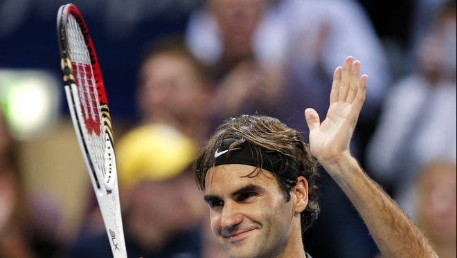 Roger Federer celebrates his straight-set victory Friday over France's Benoit Paire in the quarterfinals of the Swiss Indoors.
