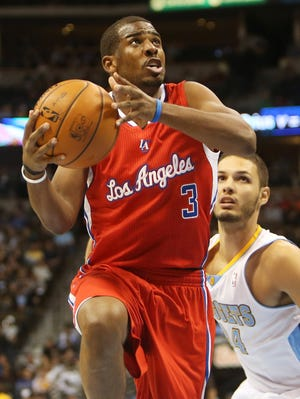 Los Angeles Clippers guard Chris Paul drives to the basket against the Denver Nuggets on Thursday.