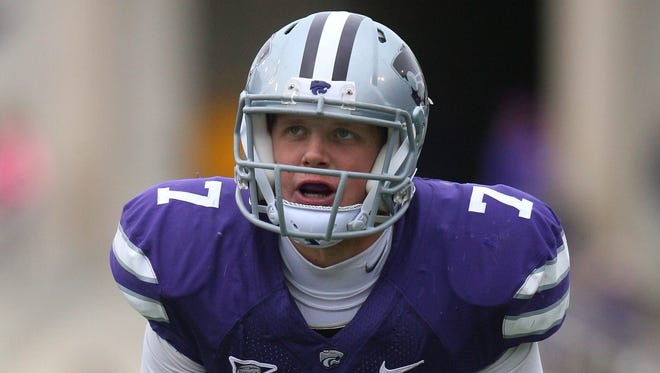 Kansas State Wildcats quarterback Collin Klein (7) waits for the snap during a 56-16 win over the Kansas Jayhawks at Bill Snyder Family Stadium.