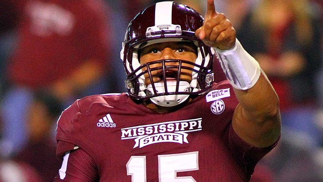 Mississippi State Bulldogs quarterback Dak Prescott (15) points to the stands after scoring a touchdown during the game against the Middle Tennessee Blue Raiders at Davis Wade Stadium. Mississippi State Bulldogs won 45-3.