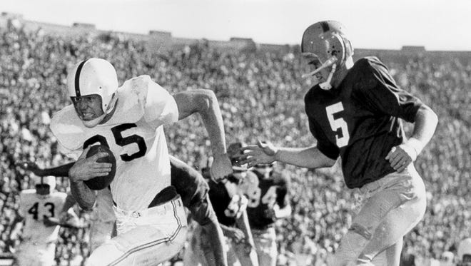 Oklahoma's Clendon Thomas eludes Notre Dame's Paul Hornung during the Sooners' 40-0 win in 1956. Yet the Irish got revenge the next year, with an improbable 7-0 victory at second-ranked Oklahoma in 1957. That victory ended the Sooners' NCAA-record winning streak at 47 games.