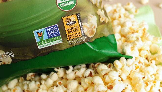 A label on a bag of popcorn indicates it is a non-GMO food product, in Los Angeles, California.